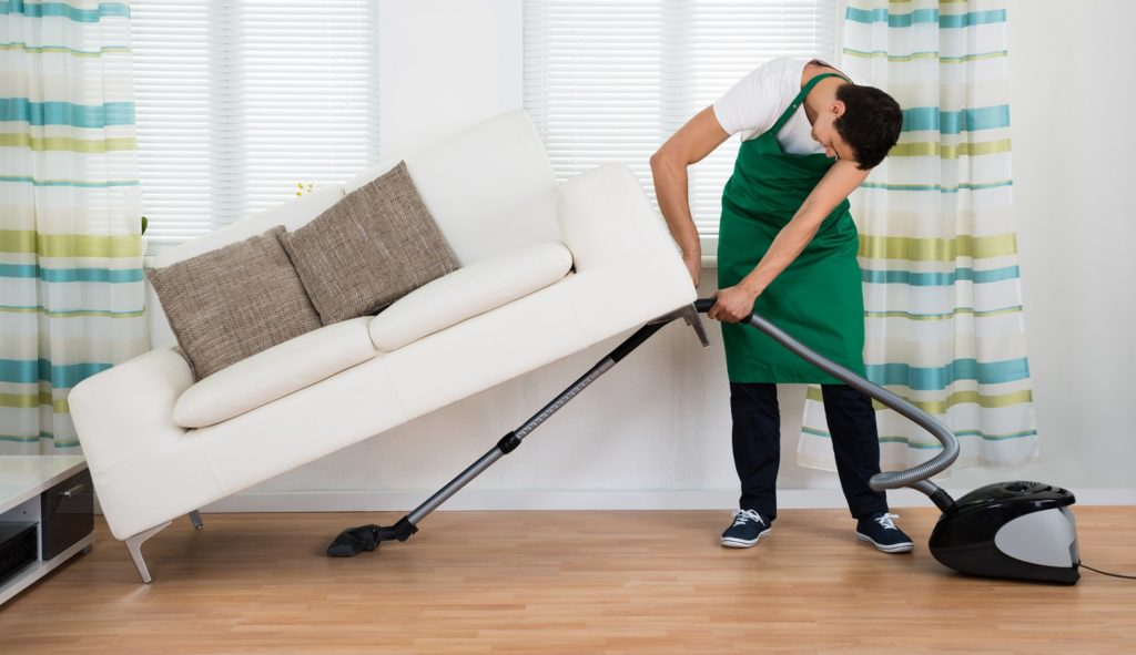 vacuuming under the couch